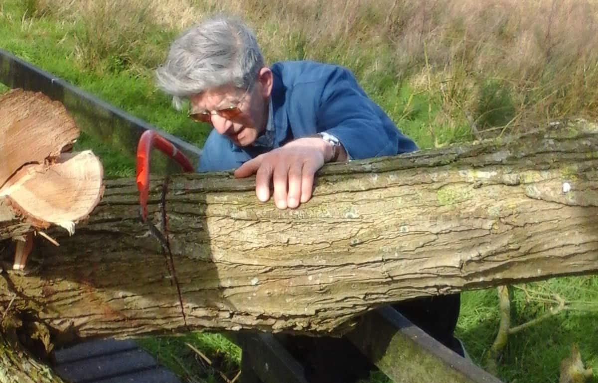 David Proctor cutting wood saw hacksaw farm organic fordhall
